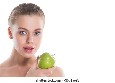Beautiful young nude woman with green apple close up isolated on white background