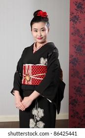 f1ad77b13a Beautiful young oriental woman wearing black Japanese traditional kimono