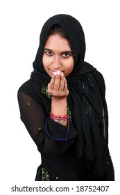 Beautiful young Pakistani girl greeting in a traditional way.