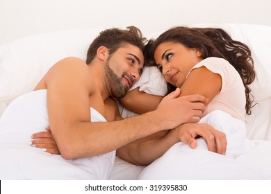 A beautiful young passionate couple in bed