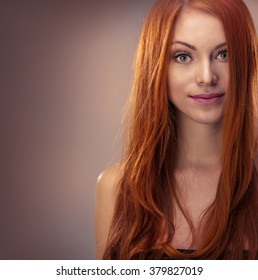 Beautiful young red-haired girl, studio