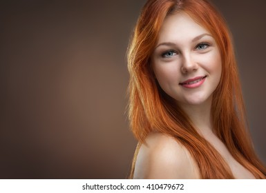 beautiful young red-haired woman in studio