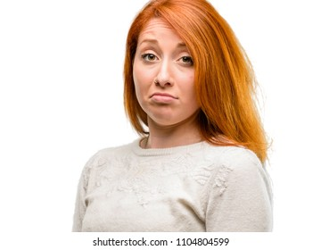 Beautiful young redhead woman having skeptical and dissatisfied look expressing Distrust, skepticism and doubt isolated over white background