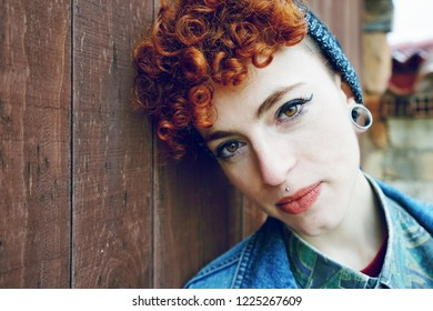 Beautiful and young redhead woman wearing vintage clothes