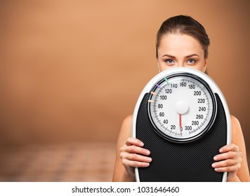 Beautiful young s woman holding scales