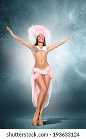 Beautiful young samba dancer in pink stage costume