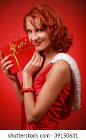 beautiful young Santa-girl with present