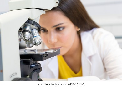 Beautiful young scientist working at the laboratory