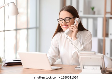 Beautiful young secretary working in office