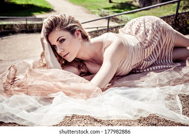 Beautiful young sensual woman in the summer park
