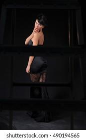 beautiful young sensual women posing in studio, model wearing black evening dress