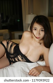 beautiful young sexy asian girl nude art in underwear on the bedroom