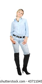 Beautiful young sexy blonde woman in jeans, blue short and high hills boots standing isolated on white background