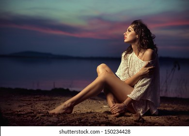Beautiful young sexy fashion model by the sea