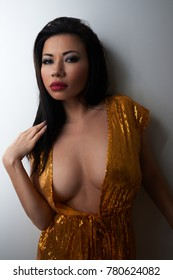 beautiful young sexy half-naked girl asian in bathrobe