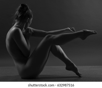 Beautiful young sexy woman over dark background
