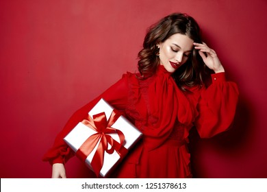 Beautiful young sexy woman thin slim figure evening makeup fashionable stylish dress clothing collection, brunette, gifts boxes red silk bows holiday party birthday New Year Christmas Valentine's Day.