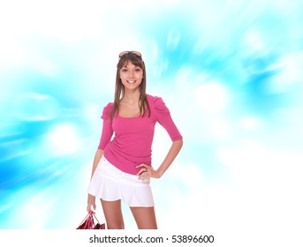 Beautiful young shopping woman posing over gray background
