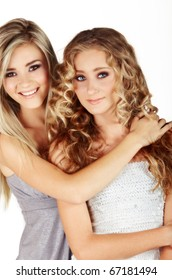 beautiful young sisters with long blond hair smiling in party dresses - not isolated