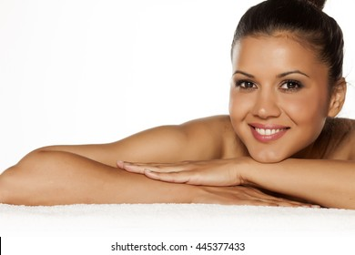 beautiful young smiling latina lying on the towel