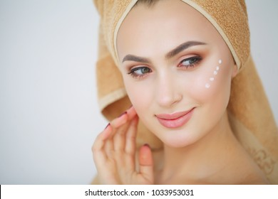 Beautiful young smiling woman with clean fresh skin look away .Girl beauty face care. Facial treatment . Cosmetology , beauty and spa