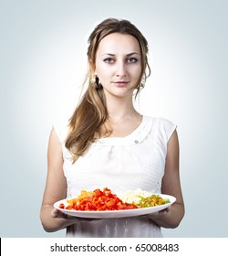beautiful young smiling woman with dish of vegetables