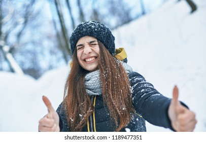 beautiful young smiling woman in good winter