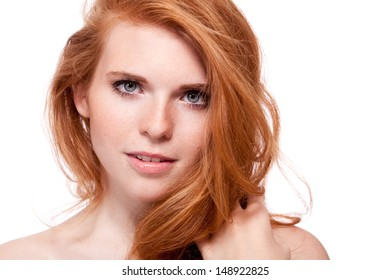 beautiful young smiling woman with red hair and freckles isolated on white portrait