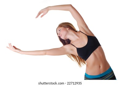 Beautiful young sports woman doing gymnastics exercises
