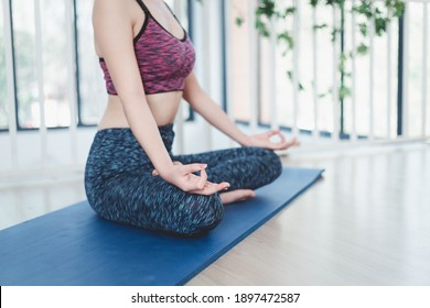A beautiful Young sportswoman doing exercises and doing yoga fitness, sport and healthy lifestyle.   people stay at home healthy concept