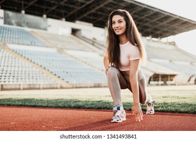 Beautiful young sportswoman doing fitness exercises.