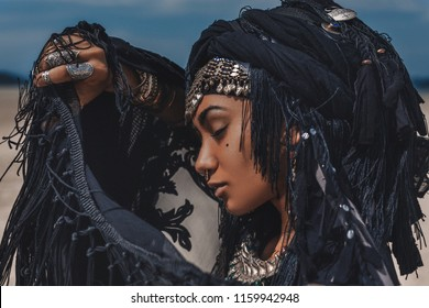 Beautiful young stylish tribal dancer. Woman in oriental costume outdoors