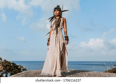 beautiful young stylish woman in elegant dress outdoors at sunset
