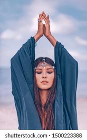 Beautiful young stylish woman portrait outdoors. shaman concept