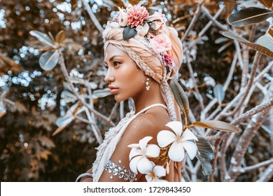 beautiful young stylish woman wearing flowers wreath outdoors portrait