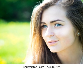Beautiful young summer woman with blue eyes