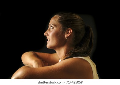 Beautiful young suntanned woman athlete, age 19, portrait