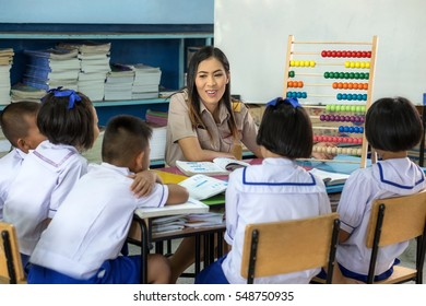 Beautiful young teachers use Instructional media for teach the students in classroom. Asian teacher wearing uniform Thailand teachers.