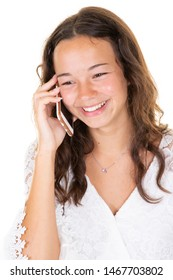 Beautiful young teen woman talking on mobile phone standing near white wall