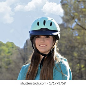 A beautiful young teenage girl ready for a horseback ride.