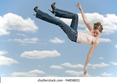 A beautiful young teenage woman falling through the sky