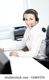 Beautiful young telephone operator smiling