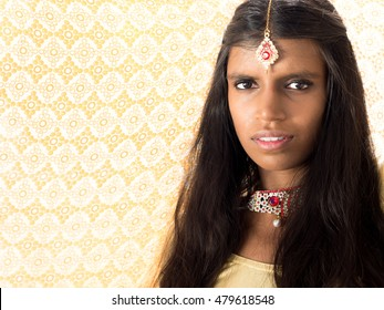 Beautiful and young traditional hindu woman under a backlighting veil. Oriental princess from stories concept
