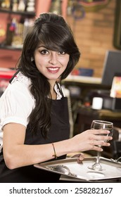 beautiful young waitress girl serving a drink holding tray