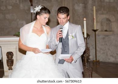 Beautiful young wedding couple in church