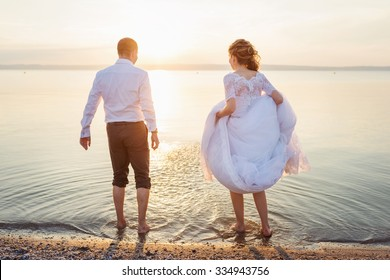 Beautiful young wedding couple at the shore