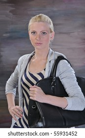 beautiful young woman 20-25 years with road bag