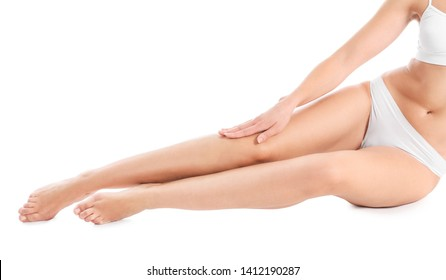 Beautiful young woman after laser hair removal of legs on white background