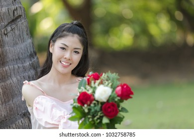 beautiful young woman asian girl happy smiling with roses red in valentines day  picture style vintage