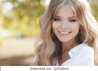 beautiful young woman autumn portrait. outdoor. smiling girl